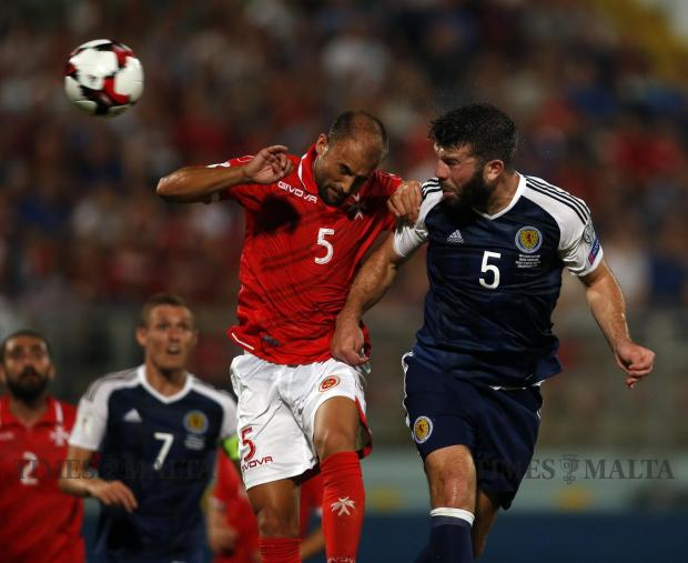 Scotland's Grant Hanley (right) attempts to score a goal during an aerial challenge with Malta's Andrei Agius during their 2018 World Cup qualifier at the National Stadium in Ta' Qali on September 4. Photo: Darrin Zammit Lupi