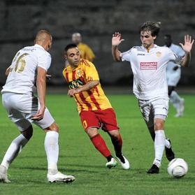 Birkirkara's Fabrizio Miccoli (centre) passes the ball forward against Ulisses at the Hibs Stadium, yesterday. Photo: Chris Sant Fournier