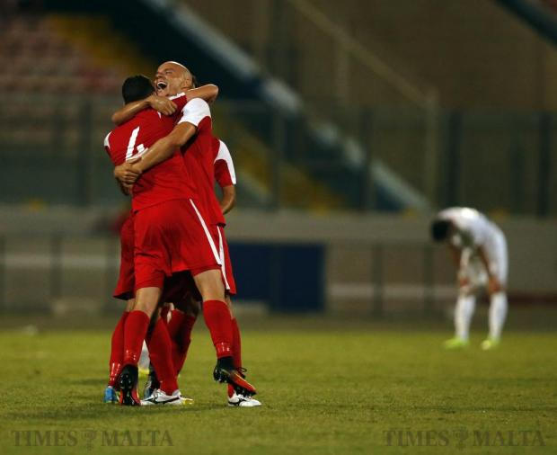 Balzan's players celebrate after defeating Floriana 1-0 in their Premier League football match at the National Stadium in Ta' Qali on September 10. Photo: Darrin Zammit Lupi