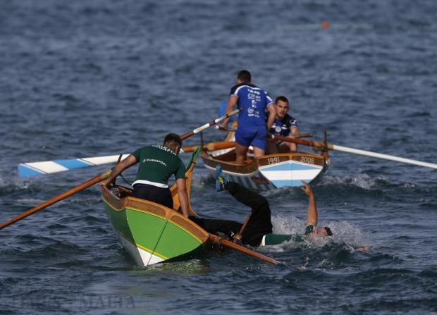 An oarsman falls out of his boat during the Freedom Day Regatta in Valletta's Grand Harbour on March 31. Rowing teams from the cities and towns surrounding Grand Harbour take part in the annual contested event, part of the celebrations commemorating the closure of the British naval and air bases on the island in 1979. Photo: Darrin Zammit Lupi