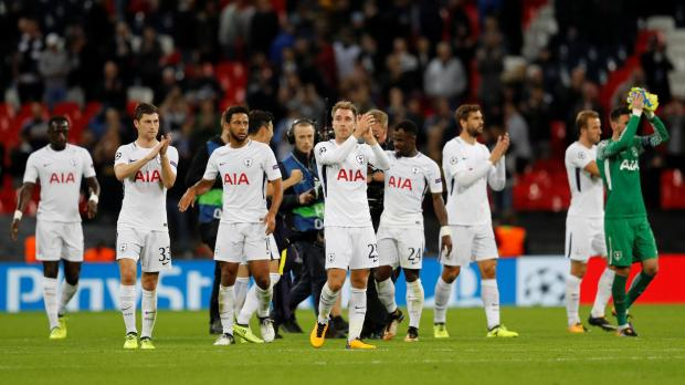 Tottenham's Christian Eriksen applauds fans after the match with team mates.