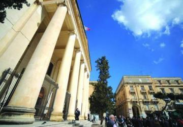 Nine years on, a husband is cleared of injuring his wife