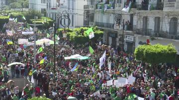 Massive protests in Algeria, as activists demand president step down   Protesters say the president must step aside. Video: AFP
