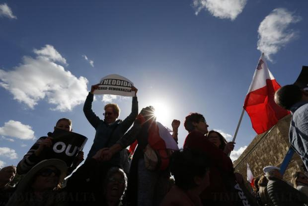 Protestors take part in a demonstration calling on Prime Minister Joseph Muscat to resign after two members of his government were named in the Panama Papers leak scandal, outside the office of the Prime Minister at Castille Place in Valletta on April 10. Photo: Darrin Zammit Lupi