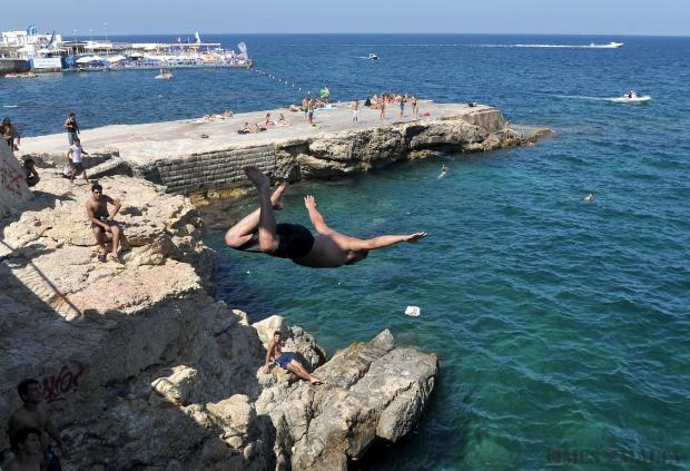 A man dives into the sea from the promenade in Ghar id-Dud in Sliema on August 10. Photo: Chris Sant Fournier