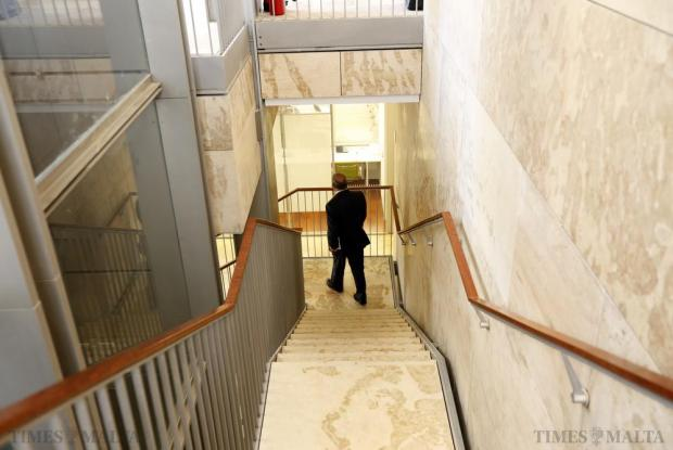 Former Minister Austin Gatt walks down to the lower floors of Parliament House before facing the Public Accounts Committee during its oil procurement investigation on June 30. Photo: Darrin Zammit Lupi