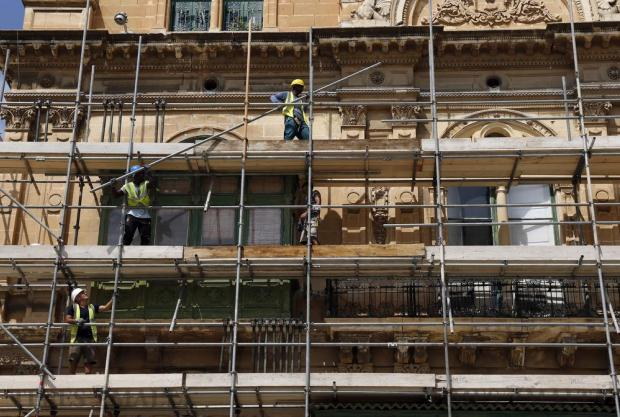 Workers erect scaffolding on the facade of Palazzo Ferreria in Valletta on September 14. Photo: Darrin Zammit Lupi