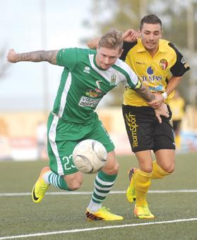 Floriana winger Gary Muir holds off the challenge of Leighton Grech yesterday. Photo: Chris Sant Fournier