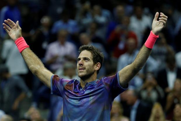 Juan Martin Del Potro celebrates his victory over Roger Federer.