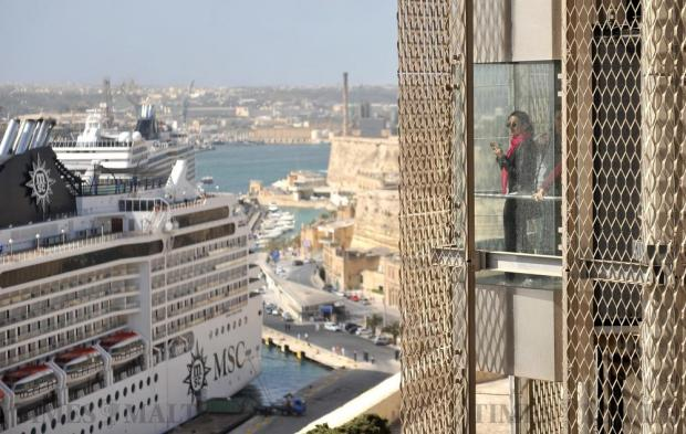 A woman looks out from the Barrakka lift towards Grand Harbour on April 20. Photo: Chris Sant Fournier