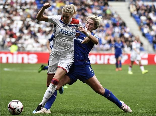 Lyon's Norwegian forward Ada Hegerberg (L) fights for the ball against Chelsea's English defender Millie Bright.