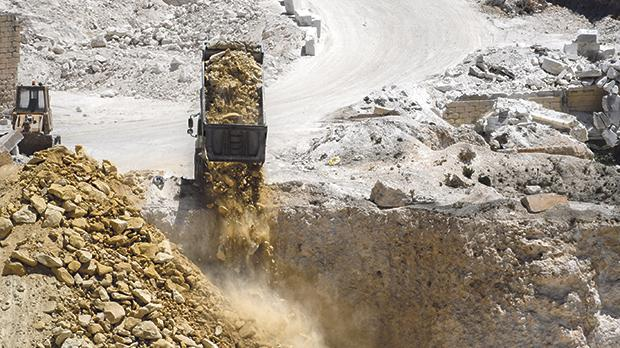 Construction waste being dumped in the quarry at Siġġiewi, which is private property.