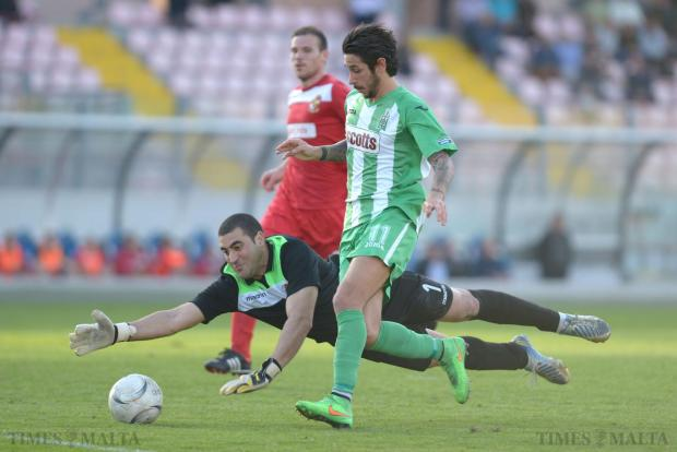 Naxxar Lions goalkeeper Julian Azzopardi dives full stretch to close the way for Floriana striker Matteo Piciollo during their Premiership match at the National Stadium in Ta'Qali on April 26. The Greens won the match 4-1. Photo: Matthew Mirabelli