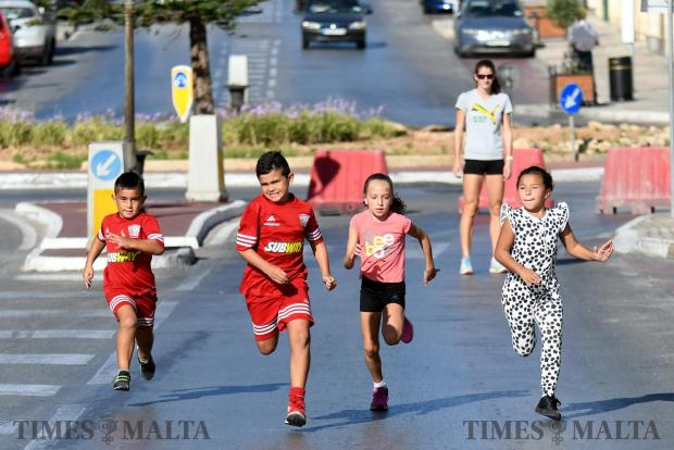 Children enjoy a run in the street during car free day in Fgura on September 21. Photo: Jonathan Borg
