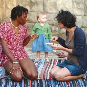 An African woman and a European woman talk during a musical integration party at the Peace Lab complex in Ħal Far last summer. Photo: Darrin Zammit Lupi
