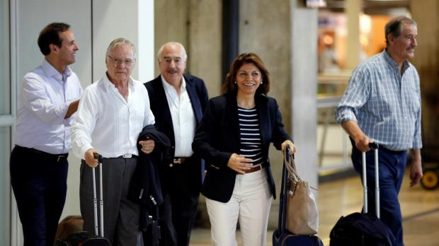The former presidents of Costa Rica Laura Chinchilla and Miguel Angel Rodriguez, Colombia's former president Andres Pastrana, Bolivia's former president Jorge Quiroga and Mexico's former president Vicente Fox arrive at Caracas airport ahead of the unofficial plebiscite. Photo: Reuters/Andres Martinez Casares