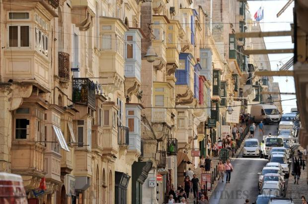 Maltese balconies hang over Republic Street in Valletta on October 12. Photo: Chris Sant Fournier