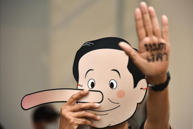 The masks mocked Prime Minister Prayuth Chan-ocha, with activists comparing him to Pinocchio. Photo: Reuters