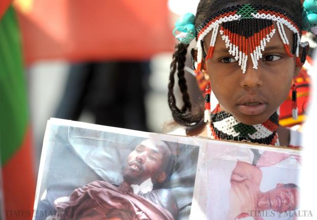 A young Ethiopian girl participates in a protest against the Ethiopian government's eviction of Oromo farmers to make way for an industrial zone in front of the Prime Minister's office in Valletta on June 16. Photo: Matthew Mirabelli
