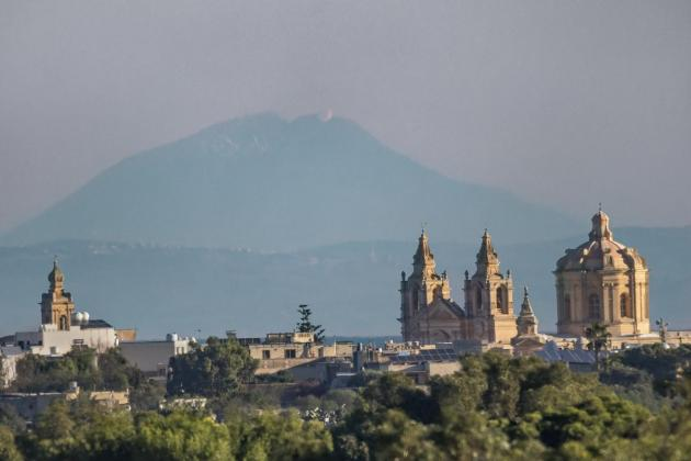 Sicily's Mount Etna rises behind Mdina in stunning photo
