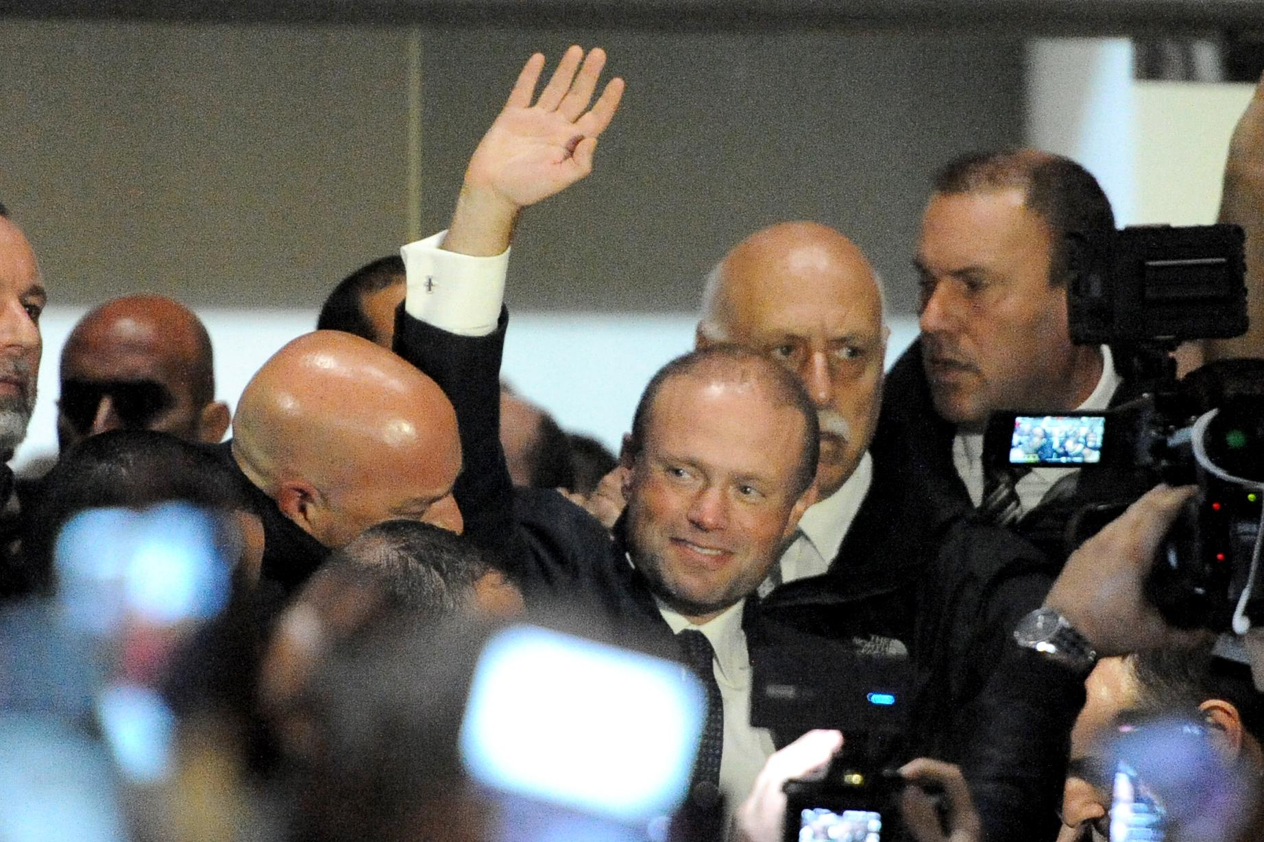 Joseph Muscat waves at supporters outside Labour party headquarters on Monday night. Photo: Chris Sant Fournier
