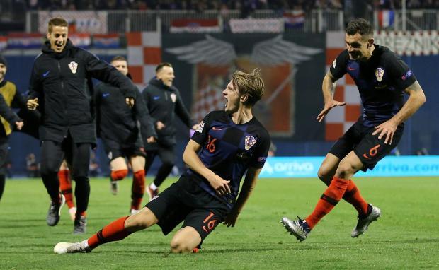 Croatia's Tin Jedvaj celebrates scoring their third goal with team mates.