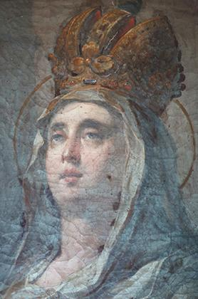 A detail of the painting showing St Helen before the conservation works commenced.