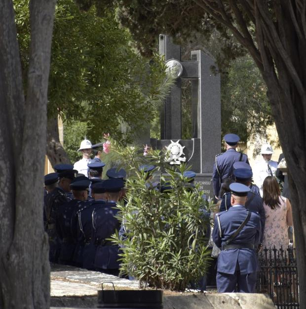 Policemen pay their respects to deceased former colleagues at the Addolorata cemetery in Paola on July 3. Photo: Mark Zammit Cordina