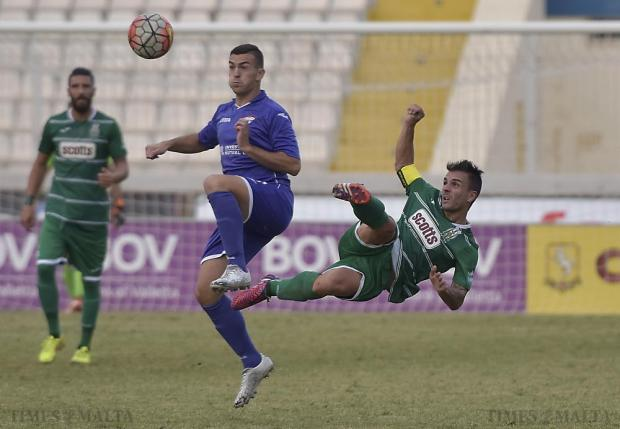 Floriana's Nicolas Chiesa (right) and Balzan's Lydon Micallef (left) challenge for the ball during their Premier League football match at the National Stadium in Ta'Qali on October 25. Photo: Mark Zammit Cordina