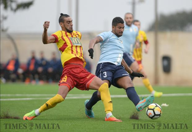 Birkirkara's Waldemar Jesus Acosta Ferreria (left) and Naxxar Lions' Malison Souza Duarte vie for the ball during their BOV Premier League match at the Centenary Football Stadium in Ta'Qali on February 3. Photo: Matthew Mirabelli