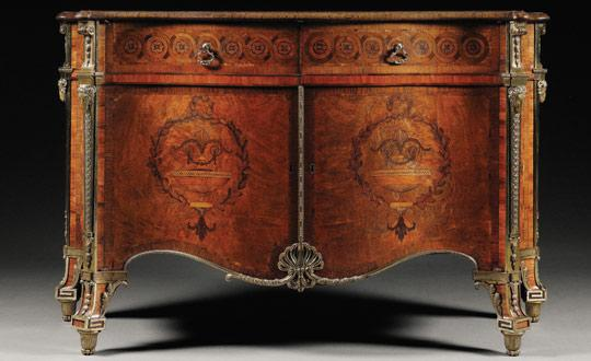 An ornate chest of drawers thought to be crafted by Thomas Chippendale which has sold at auction for more than £3.7 million. Photo: Sotheby's/PA Wire