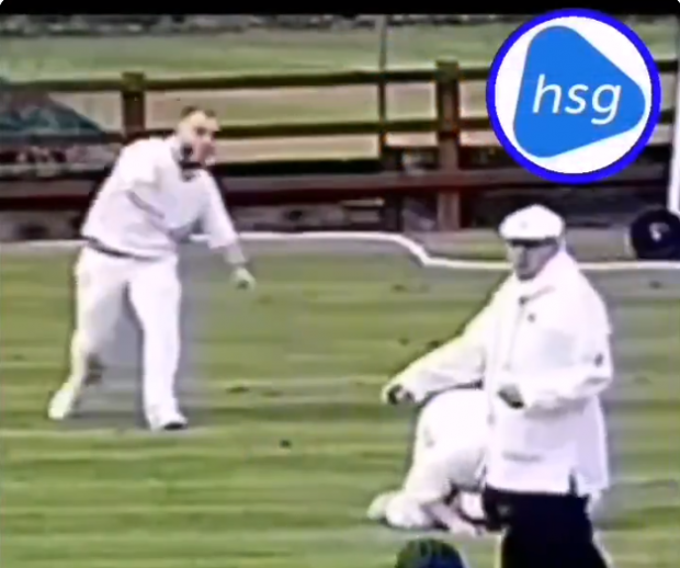 The club's video shows the prostrate fielder getting hit by the ball lobbed by his team mate. Screen grab via Twitter.
