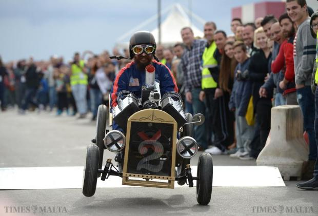 One of the participants in the soap box car competition lands on one wheel after going over the ramp which forms part of the course at Paqpaqli Ghall-Istrina car show at Hal Farrug on December 7. Photo: Matthew Mirabelli