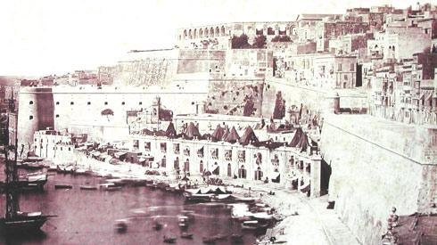 An early sepia photo of Barriera Wharf as viewed from the Lower Barrakka Gardens.
