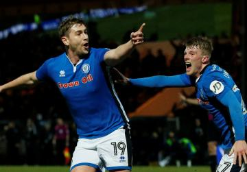 Rochdale sub Davies stuns Spurs to force replay