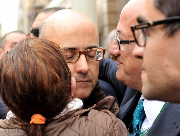 Shadow Justice Minister Jason Azzopardi is hugged by a sympathizer shortly before arriving at the law courts in Valletta on April 6. Photo: Chris Sant Fournier