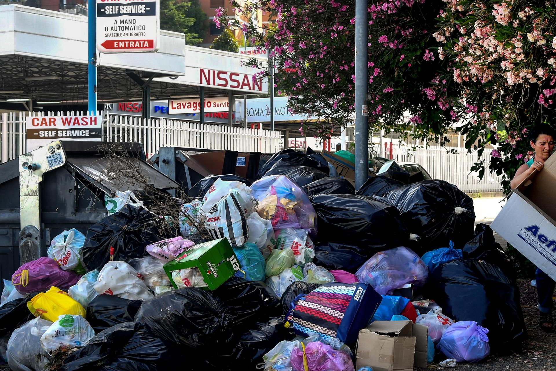 Mounds of rubbish pile up on the side of a street in Rome's Due Ponti district. Photo: AFP