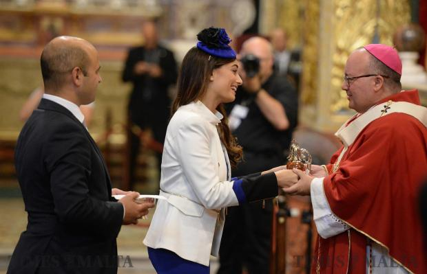 Newly elected member of parliament Rosianne Cutajar presents the offertory to Archbishop Charles Scicluna during a mass at St John's Co Cathedral in Valletta on June 24 celebrating the opening of Malta's 13th Parliament. Photo: Matthew Mirabelli
