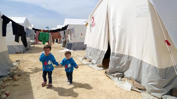 Limar and Masa al-Qari, suspected poison gas attack survivors walk outside in Northern Aleppo countryside