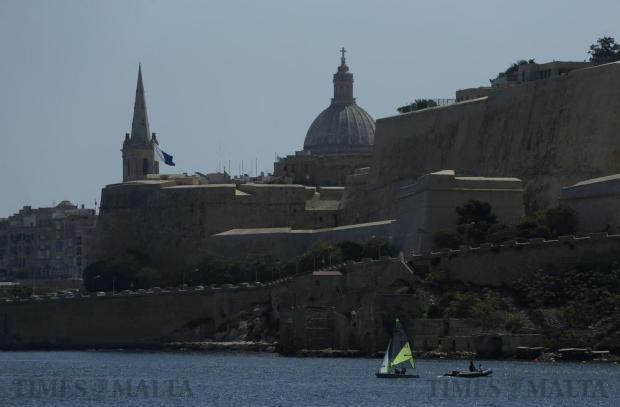Young sailors take part in a training exercise beneath the bastions of Valletta in Marsamxett Harbour on July 7. Photo: Darrin Zammit Lupi