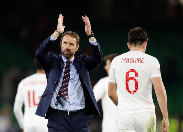 England manager Gareth Southgate applauds their fans after the match.