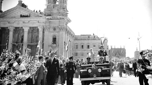 Queen Elizabeth and Prince Philip are given an enthusiastic welcome by children on the Floriana Granaries during their visit to Malta in 1954 as part of their world tour of the Commonwealth.