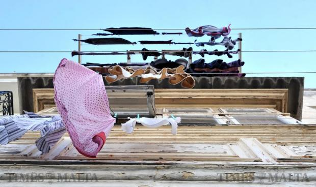 Clothes hang to dry from a wooden Maltese balcony in Valletta on December 5. Photo: Chris Sant Fournier