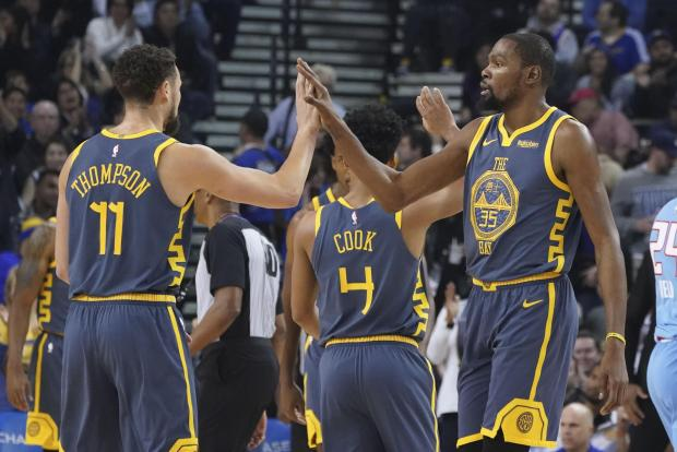Golden State Warriors forward Kevin Durant (35) and guard Klay Thompson (11) celebrate against the Sacramento Kings during the first quarter at Oracle Arena. Mandatory Credit: Kyle Terada-USA TODAY Sports