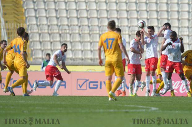 A free kick is blocked by the Maltese defence during an International friendly against Moldova at the National Stadium in Ta'Qali on March 24. Photo: Matthew Mirabelli