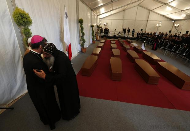 Religious leaders embrace near the coffins with the bodies of 24 migrants after an inter-faith burial service at Mater Dei Hospital in Tal-Qroqq, on April 23. An imam and a bishop led a poignant inter-faith funeral for 24 drowned migrants, the only victims whose bodies were recovered from the Mediterranean in the weekend shipwreck that shocked Europe. The dead were picked up by the Italian vessel Gregoretti and brought to Malta after their vessel capsized and sank. As many as 900 people are believed to have died. Photo: Darrin Zammit Lupi