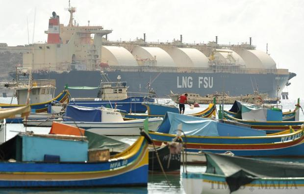 The LNG tanker Armada Mediterrana dominates the background at the fishing port of Marsaxlokk on October 19. Photo: Chris Sant Fournier