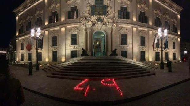 Activists left candles outside Castille Palace, referencing the 49 people who remain at sea. Photo: aditus.