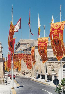 On Easter Sunday morning, the medieval city is magnificently en fête, exposing its massive, tastefully restored bastions and high cavaliers bedecked with the flags of the ancient auberges.
