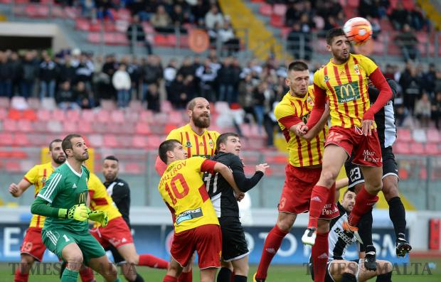 Birkirkara defender Cain Attard (right) heads the ball away during their league match against Hibernians at the National Stadium in Ta' Qali on January 29. Photo: Matthew Mirabelli